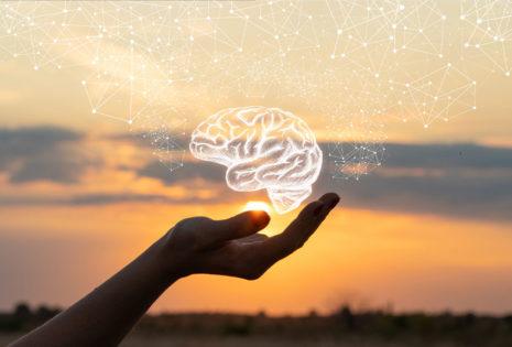 hand holding hologram of brain