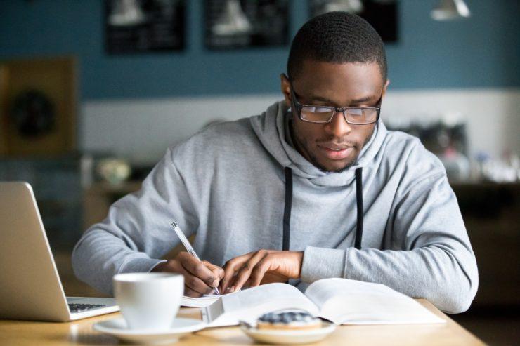 man taking notes at table