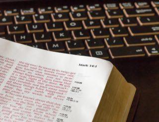 closeup of bible and computer