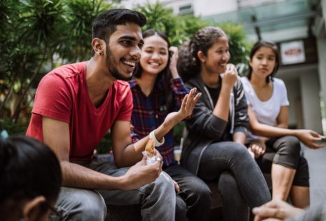 Group Of Students Joking And Getting To Know Each Other