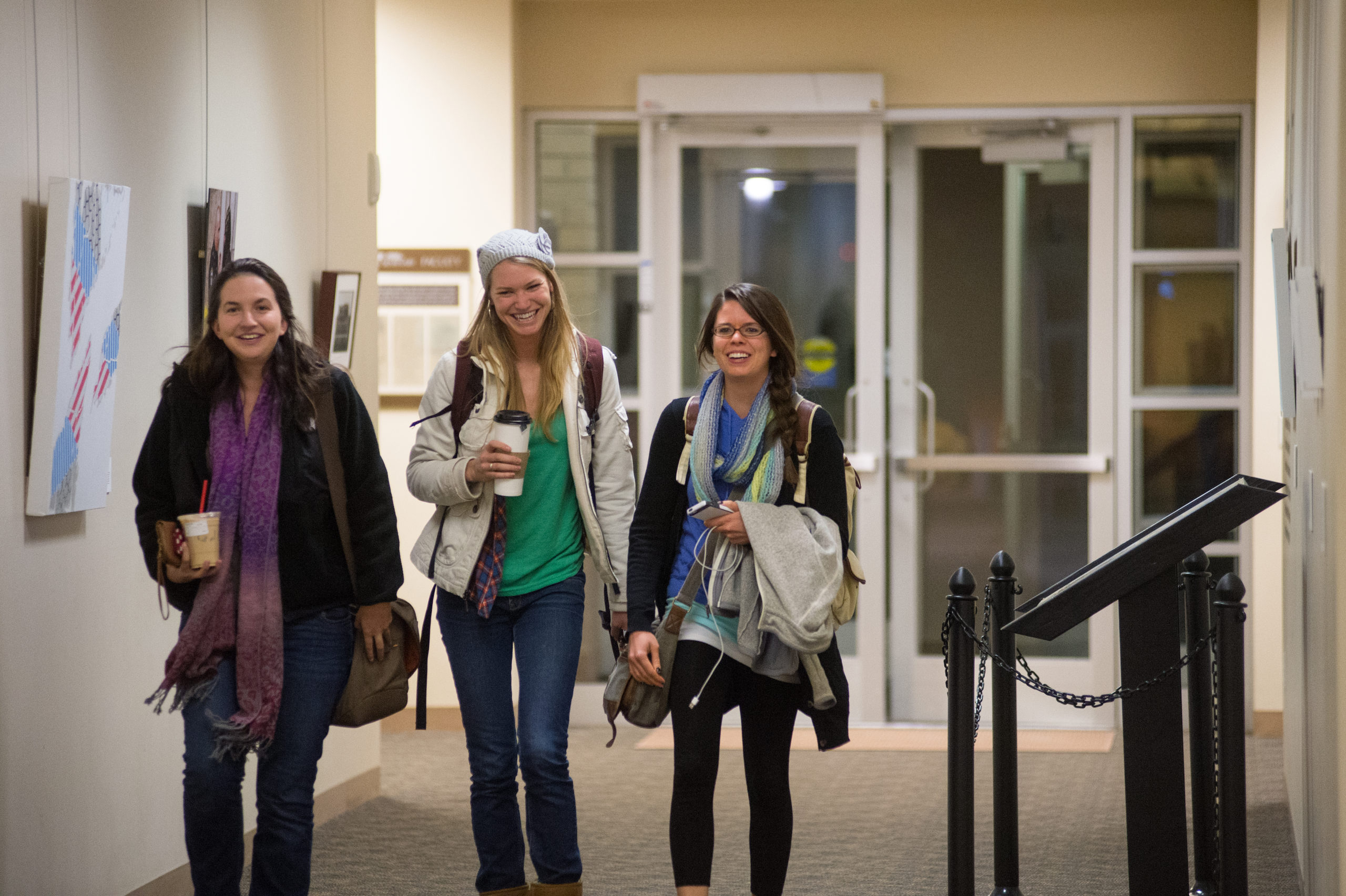 three female students talking in hallway