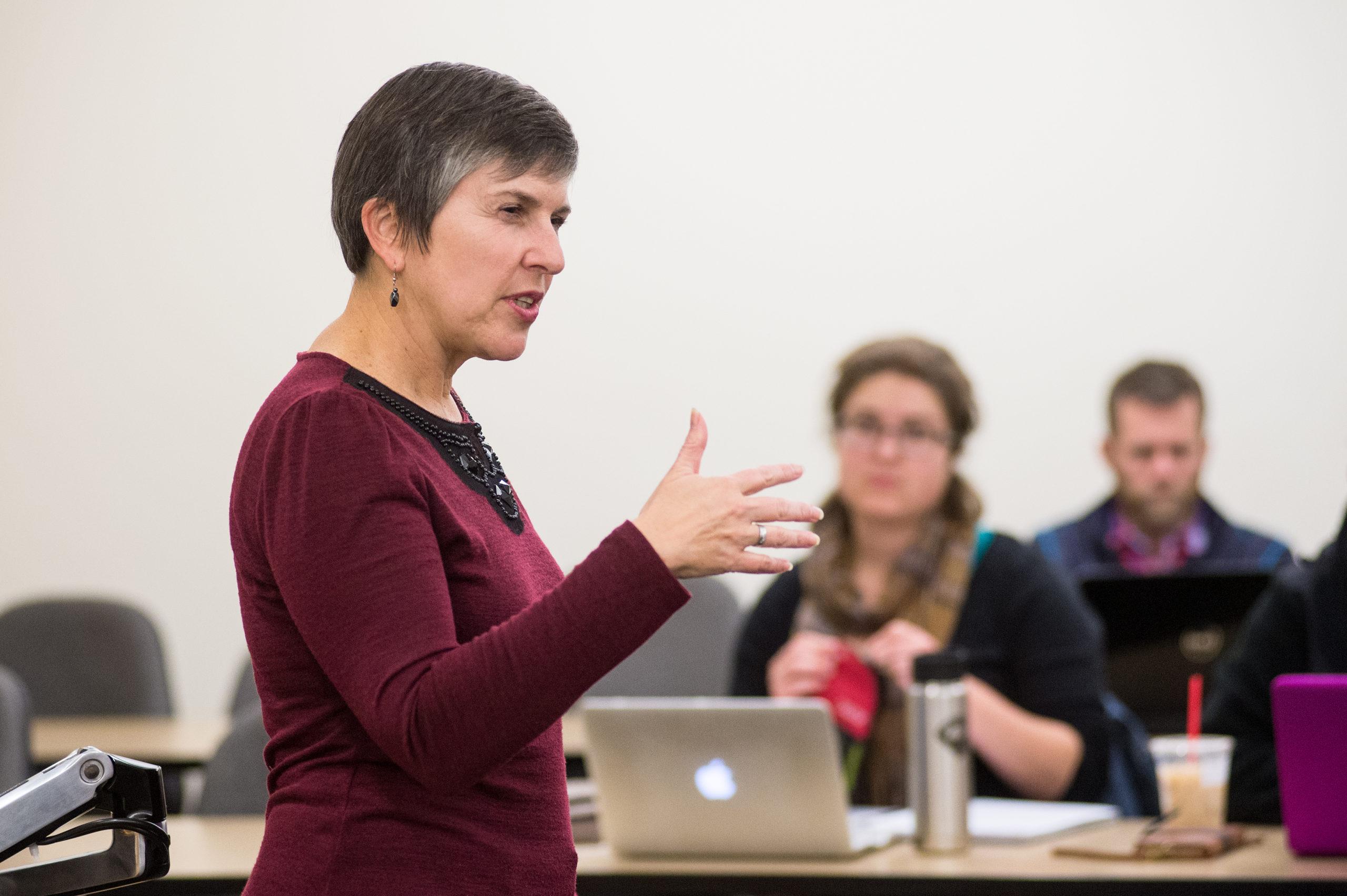 female professor speaking to class
