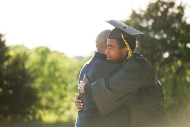 two men hugging outside