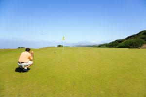 golfer looking onto hole