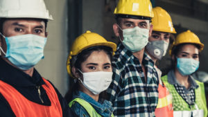 five construction workers looking at camera