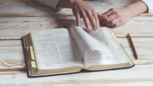 hand turning bible pages
