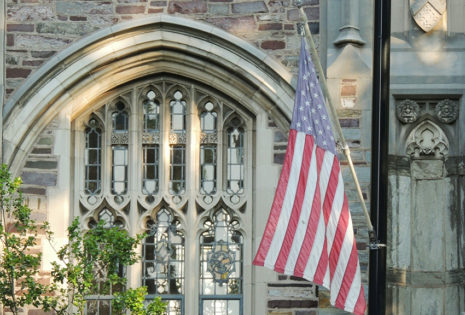 american flag in front of church