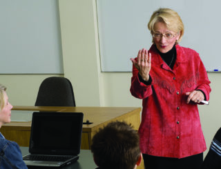 A female faculty member speaking directly to a student