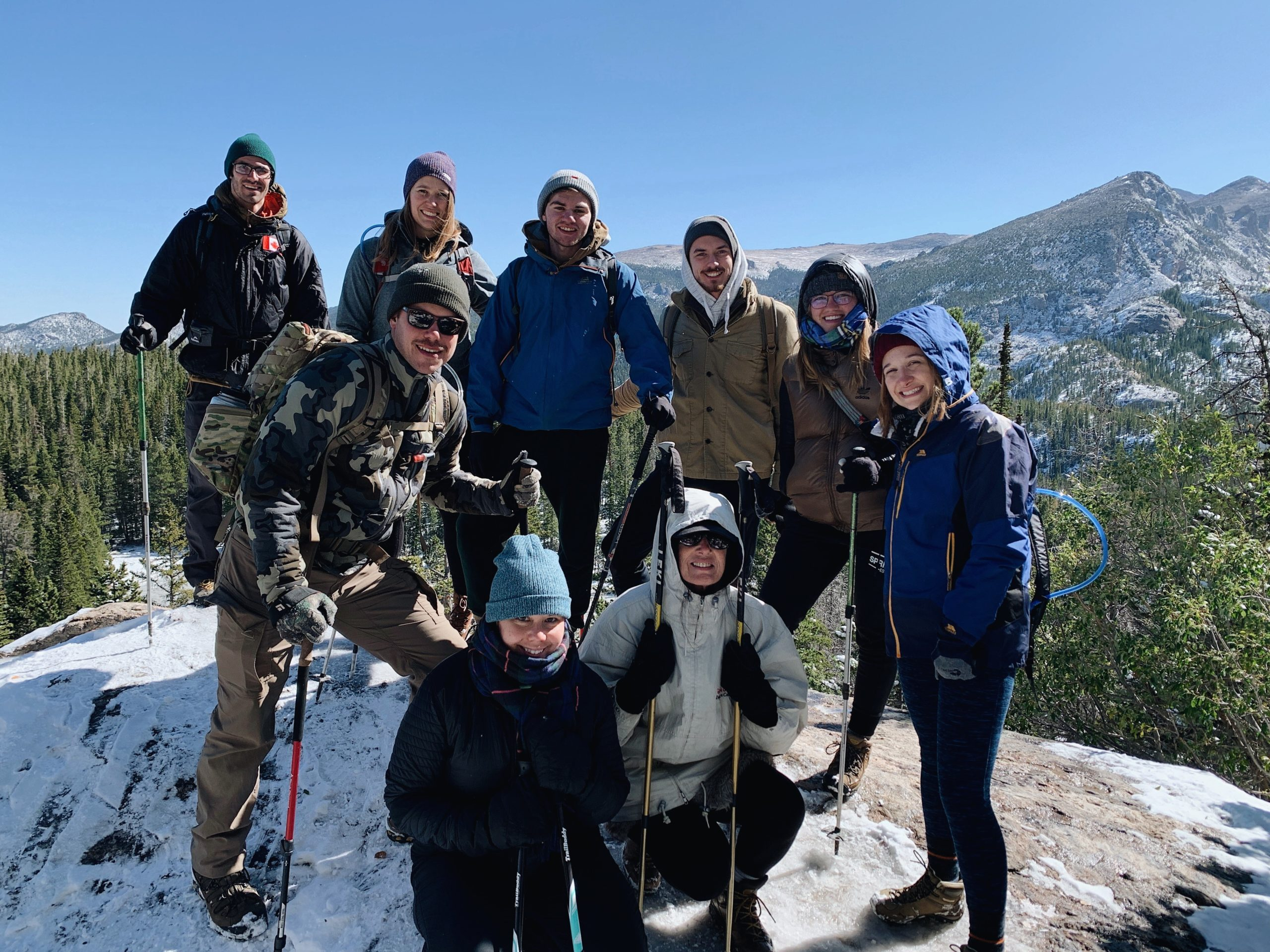 Students hiking outdoors in the mountains in the winter
