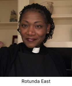 Black woman in ministers collar smiling at camera